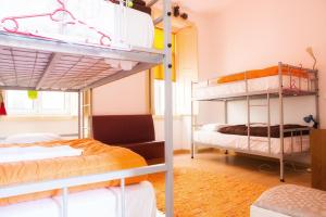 A bunk bed or bunk beds in a room at Olive Street House