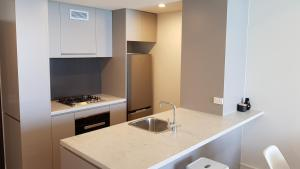 A kitchen or kitchenette at Supercar fan's dream - track side apartment #1