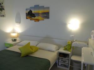 Postel nebo postele na pokoji v ubytování B&B Villa Flora