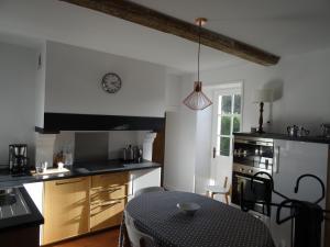 A kitchen or kitchenette at Gite de l'Abbaye d'Etrun