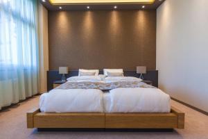 Ein Bett oder Betten in einem Zimmer der Unterkunft Plaza Hotel Winterthur