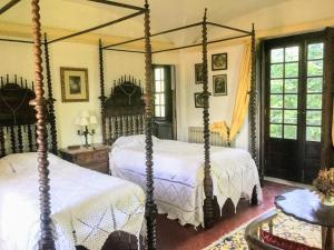 A bed or beds in a room at Quinta do Sanguinhal