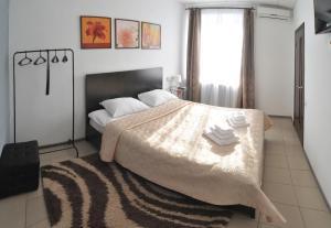 Кровать или кровати в номере Отель  Номер-ОК
