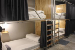 A bunk bed or bunk beds in a room at Ekanek Hostel