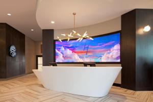 A television and/or entertainment center at H Hotel Los Angeles, Curio Collection By Hilton