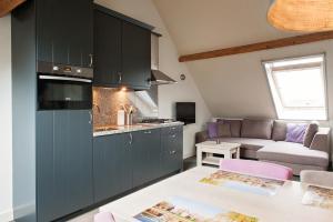 A kitchen or kitchenette at De Willigen Logies