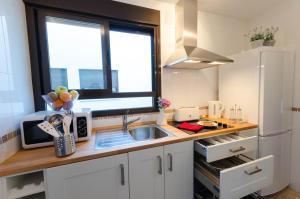 Una cocina o zona de cocina en Apartamentos Turísticos Duque de Hornachuelos