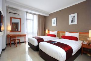 Ivory Hotel Bandungにあるベッド