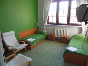 Łóżko lub łóżka w pokoju w obiekcie Szkolne Schronisko Młodzieżowe w Gdańsku