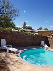 The swimming pool at or near Gorgeous Gecko Guesthouse