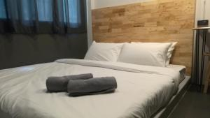 A bed or beds in a room at Ekanek Hostel
