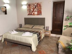 Letto o letti in una camera di B&B Villa Loriana