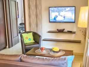 Telewizja i/lub zestaw kina domowego w obiekcie VisitZakopane - Blanco Apartment