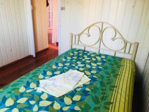 A bed or beds in a room at Casa para Temporada de Verão