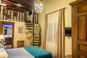 Säng eller sängar i ett rum på Palacio de Santa Inés