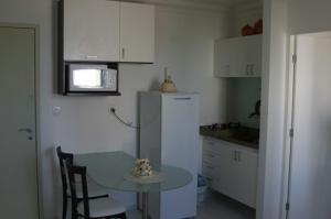 A kitchen or kitchenette at Flat em Boa Viagem - Recife