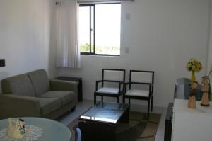 A seating area at Flat em Boa Viagem - Recife