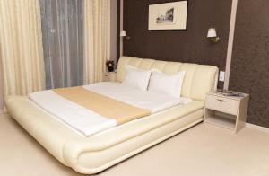 Кровать или кровати в номере Отель Очагоф