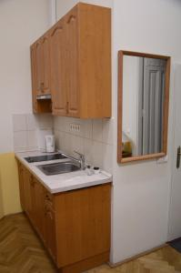 A kitchen or kitchenette at Guest Rest Studio Apartments