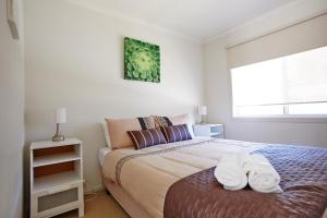 A bed or beds in a room at Rivergum Holiday Park