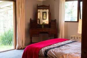A bed or beds in a room at Country Lane Lysterfield