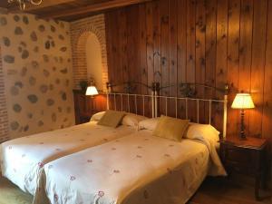 Cama o camas de una habitación en El Barondillo