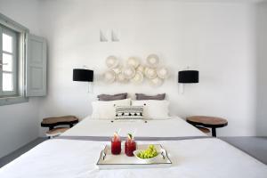 Ένα ή περισσότερα κρεβάτια σε δωμάτιο στο Blue Sand Boutique Hotel & Suites