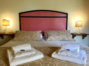 A bed or beds in a room at B&B Countryhouse Villa Baciolo