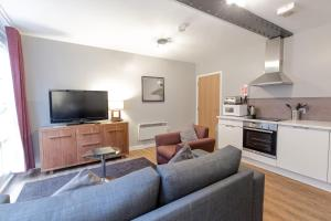 A kitchen or kitchenette at High Street Townhouse Aparthotel