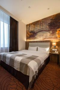 A bed or beds in a room at Hotel Inside Moskovskiy