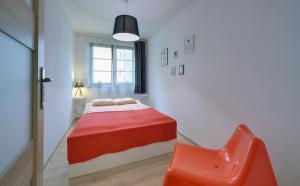 Łóżko lub łóżka w pokoju w obiekcie Truskawkowy