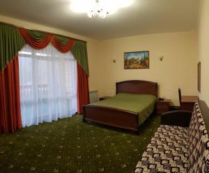 Кровать или кровати в номере Парк Отель Хвалынский