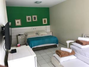 Cama ou camas em um quarto em Pousada Vila Verde