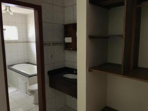 Um banheiro em Pousada Vila Verde