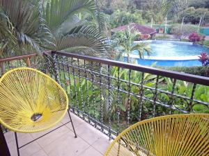 A view of the pool at The Oaks Tamarindo or nearby