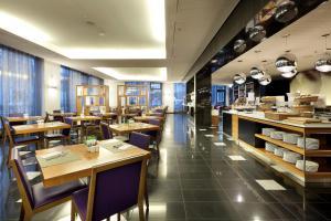 Eurostars Grand Central tesisinde bir restoran veya yemek mekanı