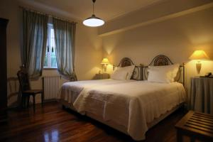 A bed or beds in a room at Quinta Da Timpeira