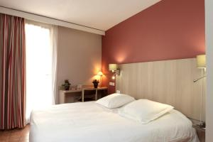A bed or beds in a room at Interhotel Cassitel
