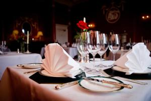A restaurant or other place to eat at Culloden House Hotel