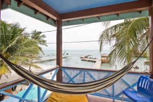 A balcony or terrace at Sandbar Beachfront Hostel & Restaurant