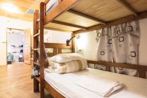 オン マイ ウェイ ジウフェン ユース ホステルにあるベッド