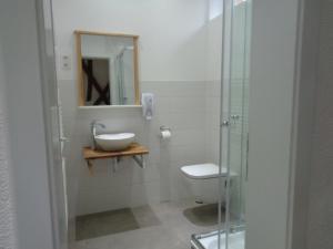 Ein Badezimmer in der Unterkunft Gästehaus zum Anker