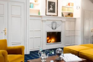 A seating area at Hotel Relais Dell'Orologio