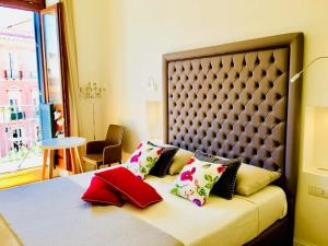 A bed or beds in a room at Antico Corso Charme