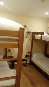 Ein Etagenbett oder Etagenbetten in einem Zimmer der Unterkunft Residencial Condado
