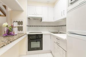 A kitchen or kitchenette at Sands Beach Resort