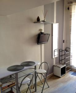 A television and/or entertainment center at Studio Roman