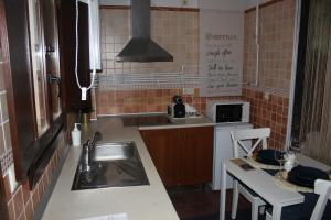 A kitchen or kitchenette at The Vanilla Suite