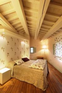 A bed or beds in a room at Urbino Resort - Tenuta Santi Giacomo e Filippo
