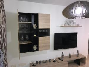 A television and/or entertainment center at La Perla Medano 1